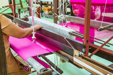 Loom for weaving silk in Thailand.
