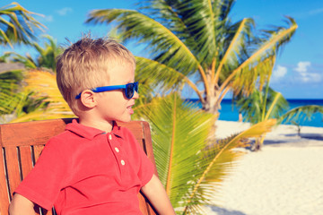 little boy waiting in cafe on tropical resort