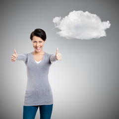 Pretty girl thumbs up, isolated on grey background with cloud
