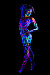 Sexy girl with body art glowing in UV light
