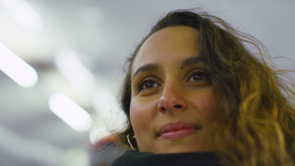 Slow motion portrait of a woman on an escalator
