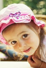 Portrait of a lovely little girl outdoors