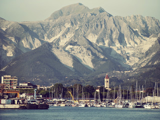 Carrara marble quarries seen from offshore - Italy. Retro look.
