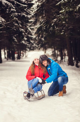 happy couple spend a fun weekend in the winter forest