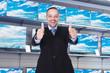 Storekeeper Gesturing Thumb Ups