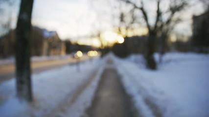 winter sidewalk in town blured video