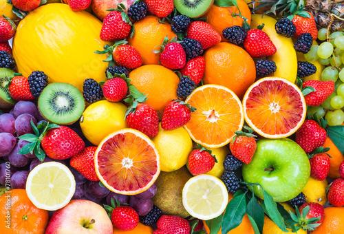 Fototapeta Fresh fruits.Mixed fruits background.