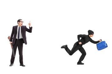 Businessman with a rifle chasing a thief