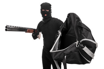 Thief with a rifle holding bag and asking for money