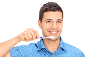 Young guy brushing his teeth