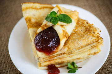 many thin pancakes with jam