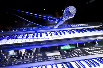 Close-Up of microphone and keyboard on stage