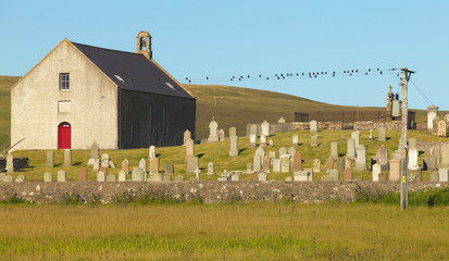 Scottish landscape with church and cemetery in Shetland. Scotlan