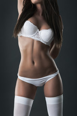 Sexy brunette with long hair in white lingerie
