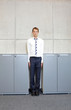 canvas print picture - white business man standng straight between cabinets in office