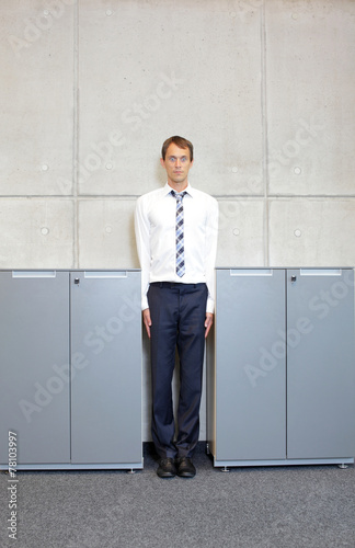 canvas print picture white business man standng straight between cabinets in office