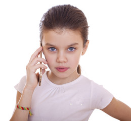 Portrait of brunette Caucasian schoolgirl calling by phone