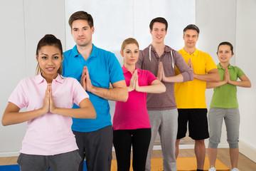 Multiethnic Group Of People Doing Yoga