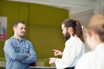 Aikido instructor talking to girl's father