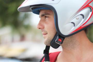 Portrait of a man in motorcycle  helmet