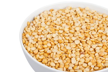 cropped image of yellow lentils in bowl