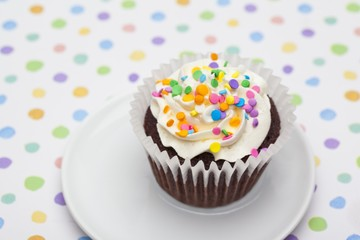 cupcake garnishes with sprinkles served in a plate