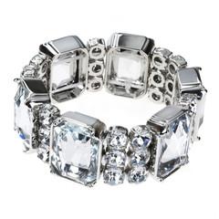 large silver bracelet over white background
