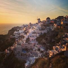 sunset in Oia white village, Santorini island, Greece