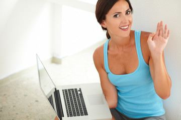 Pretty woman surfing the web on laptop