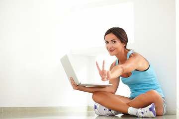 Fit woman doing the victory sign with fingers