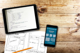 website wireframe sketch and programming code on digital tablet - 78109988