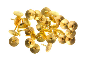 Gold thumbtacks on a white background