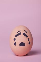 Sad orange painted egg
