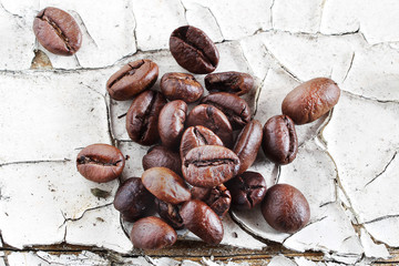 Coffee beans on rustic white background