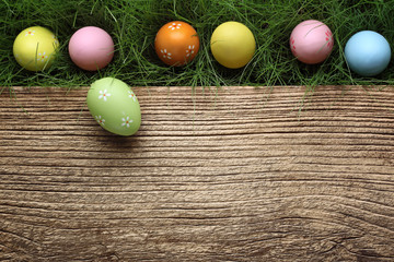 Easter eggs on wood background. Spring holidays concept