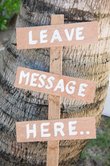 Leave message here wood lebel in garden