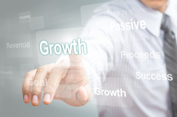 Business man pointing growth concept on touchsreen