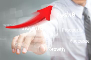 Businessman pointing a growth arrow