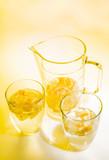 Fotoroleta Jug and two glasses of lemonade on a glass table.