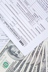 Closeup of money cash and tax form