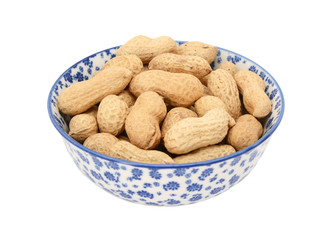 Monkey nuts in a blue and white china bowl
