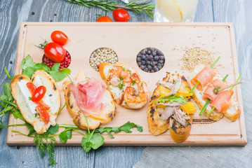 mix of traditional Spanish tapas on a wooden plate with decor