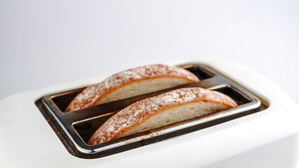 Slow motion time lapse of bread being toasted in toaster