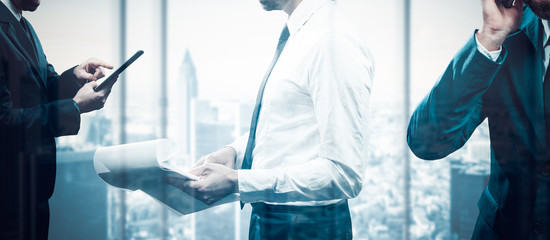 Businessman in front of window