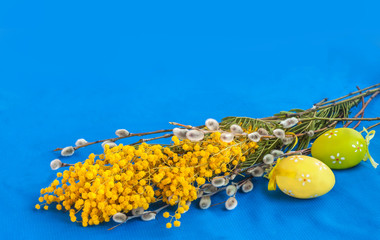 Mimosa, twigs of willow and easter eggs