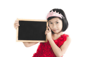 Cute Asian girl in red dress holding blank blackboard isolated o