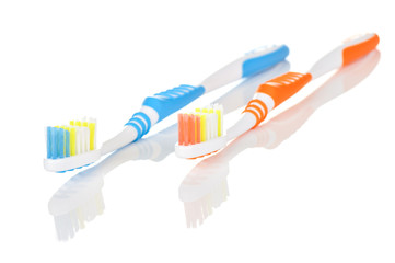 Blue and Orange Toothbrushes