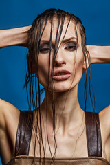 Young Sensual Brunette with Wet Hairs
