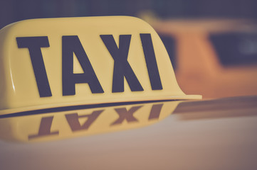 Taxi Cab Car Roof Sign Close Up in Retro Film Style