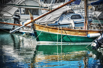 wooden boat in Alghero harbor in hdr